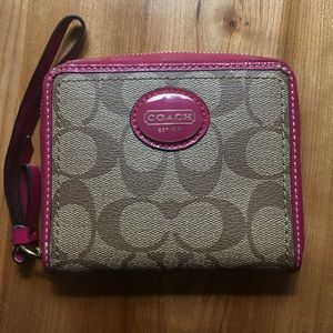 Small tan Coach zip around wallet with pink trim